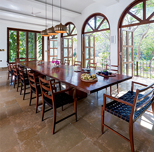 reD Architects envision a little bit of Spain in Alibaug with graceful arched openings, timeless wood furniture and ceramic details