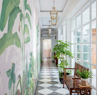 The Healing Centre by Sonia Gehlot is a sanctum of serenity with soothing hues, fresh greens and tropical wallpapers