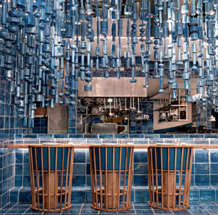 Spanish practice Masquespacio styles an ocean themed restaurant in Valencia that lures with a smorgasbord of prints and patterns