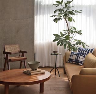Ravi Vazirani brings in his unique aesthetic and natural materials to Rohan Parikh's minimal office in Mumbai