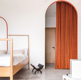 This minimalist apartment by The Act of Quad's Priyanka Itadkar and Falguni Bhatia is reminiscent of a tony art gallery with its undulating curves and popping colour